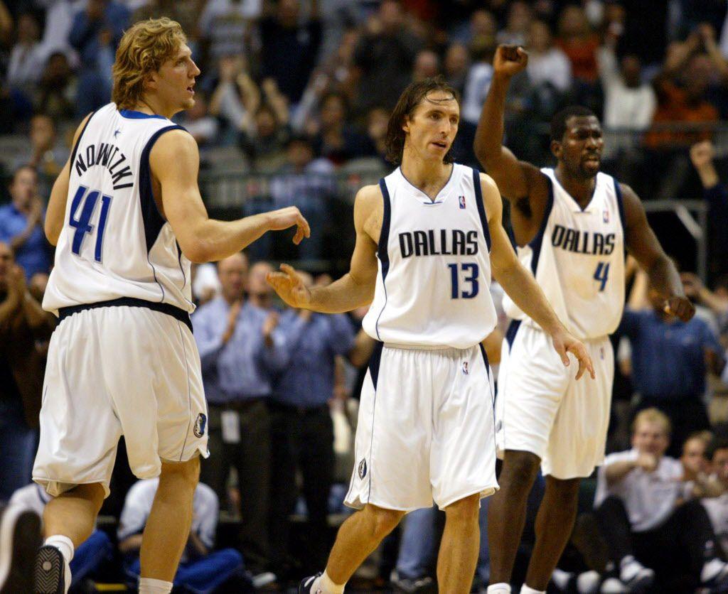 Dirk Nowitzki, left, Steve Nash, center, and Michael Finley, right, helped the Mavericks to a 27-5 start, bolstered by a 14-game winning streak to start the season.