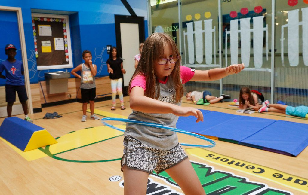 Natalie Summers, 9, counts to 10 at the hula-hoop station as she participates in a small obstacle course race in the Children's Learning Adventure gym in McKinney. The company is expanding  with new campuses coming to Allen and Flower Mound.