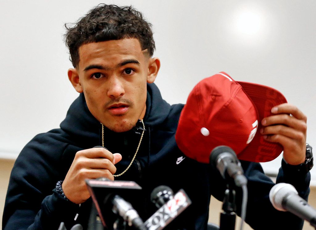 FILE - In this Thursday, Feb. 16, 2017 file photo, Norman North High School basketball star Trae Young announces he will attend Oklahoma and play for the Sooners.  (Steve Sisney/The Oklahoman via AP, File)