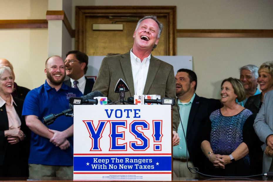 Texas Rangers bench coach and former player Steve Buechele basks in the glow of fans during a news conference Monday touting endorsements for the campaign to build a new $1 billion, retractable-roof stadium for the Rangers.