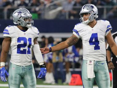 Dallas Cowboys running back Ezekiel Elliott (21) and quarterback Dak Prescott (4) are pictured during the Tampa Bay Buccaneers vs. the Dallas Cowboys NFL football game at AT&T Stadium in Arlington, Texas on Sunday, December 18, 2016.