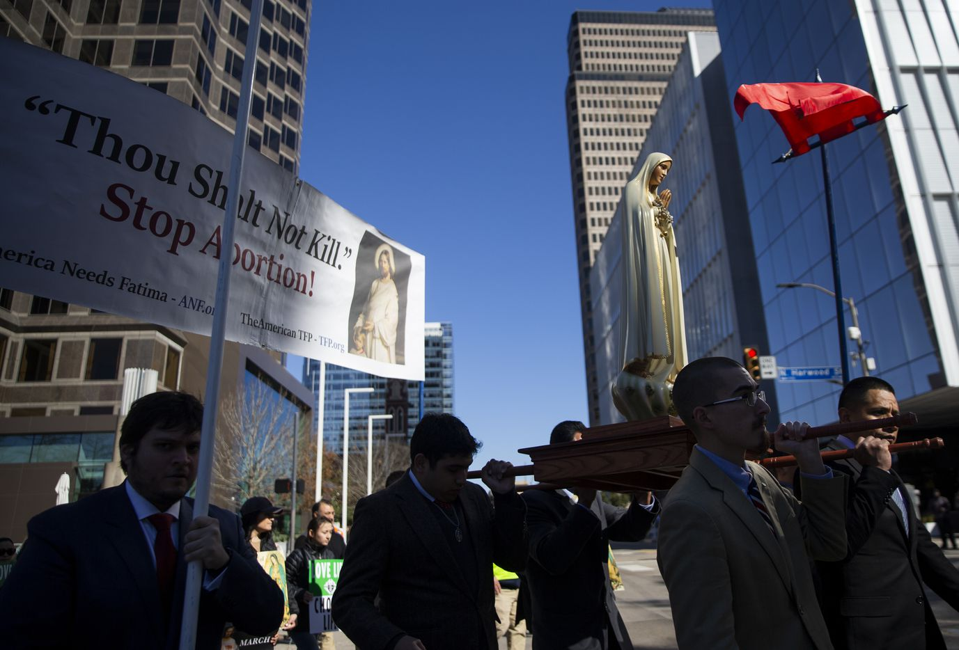 Demonstrators march from the Cathedral Santuario de la Virgen de Guadalupe to the Earle Cabell Federal Courthouse during the North Texas March for Life on Saturday, Jan. 18, 2020.