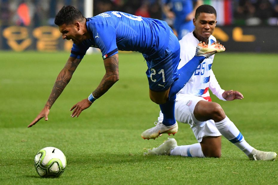 Unites States' Reggie Cannon, rear, fouls Italy's Emerson during the international friendly soccer match between Italy and the United States at Cristal Arena in Genk, Belgium, Tuesday, Nov. 20, 2018. (AP Photo/Geert Vanden Wijngaert)