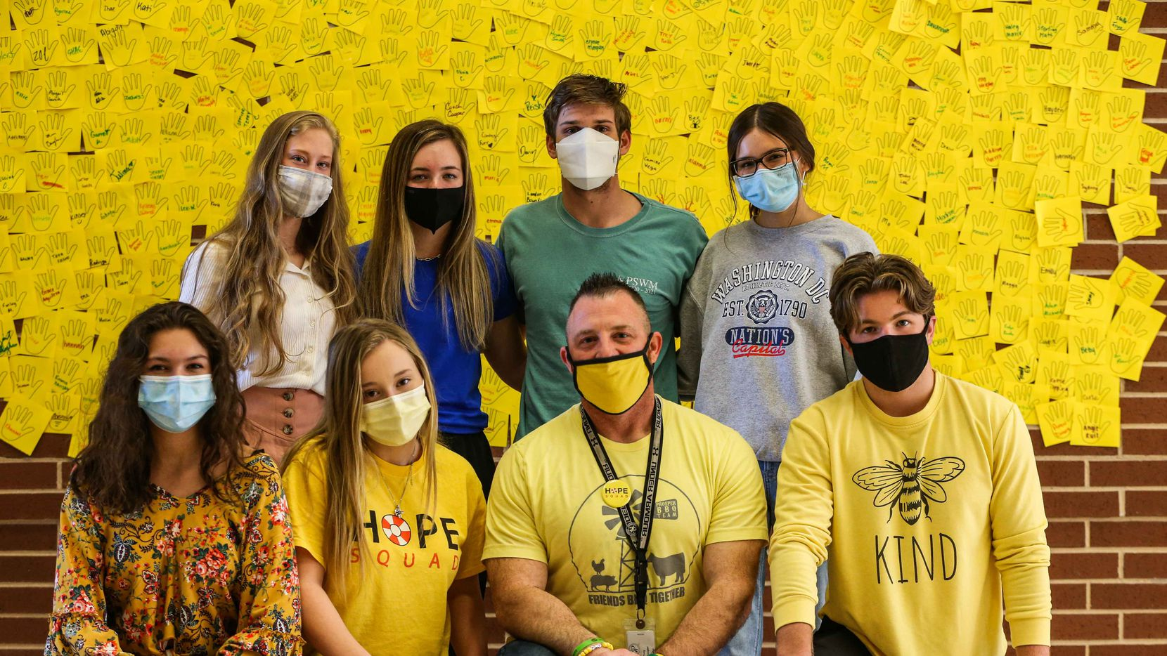 Some of the participants in Prosper High School's 75-member Hope Squad in the campus lobby, where hundreds of students signs signed yellow cards as pledges to support suicide awareness. On the front row, from left: Cameron Stulting-Flores, Baylie Bishop, adviser Tony Cooper and Sam Simonini. Back row: Reagan Starnes, Avery Fantl, Jack Diehl and Juliana Ruiz.