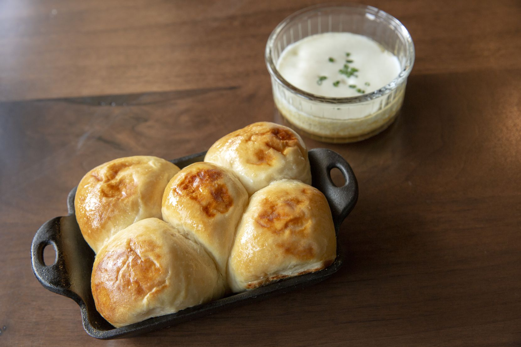 """The first thing people say about Homewood is, """"get the Parker House rolls."""" They are right: These come with parmesan mornay and chicken drippings, and you won't want to share."""