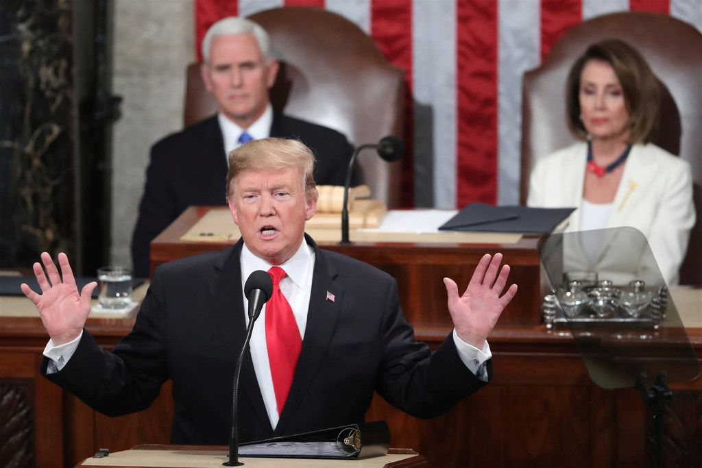 President Donald Trump delivers his State of the Union address to a joint session of Congress Tuesday on Capitol Hill in Washington, as Vice President Mike Pence and Speaker of the House Nancy Pelosi, D-Calif., watch.
