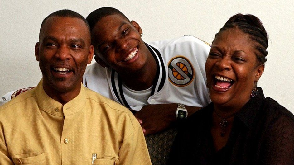 NBA draft prospect Chris Bosh (center) shares a laugh with his parents Noel (left) and Freida (right) during a portrait session at the family's home in Lancaster on Sunday, June 22, 2003. Bosh is a former Lincoln High School basketball star.