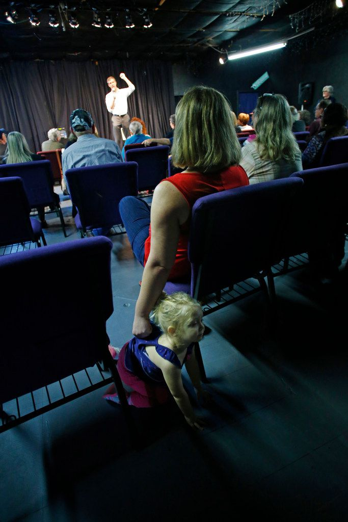 Amy Pramuk holds her child Evey Cordray, 2, as U.S. Congressman Beto O'Rourke makes a speech at the Emporium for the Arts in Woodville, Texas on Feb. 9, 2018. O'Rourke is running for the U.S. Senate. (Nathan Hunsinger/The Dallas Morning News)