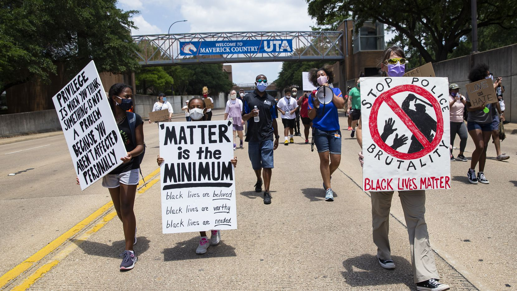 Protestors against police brutality march down S Cooper St as they participate in the UTA School of Social Work's Protest March in Arlington on Monday, June 8, 2020.