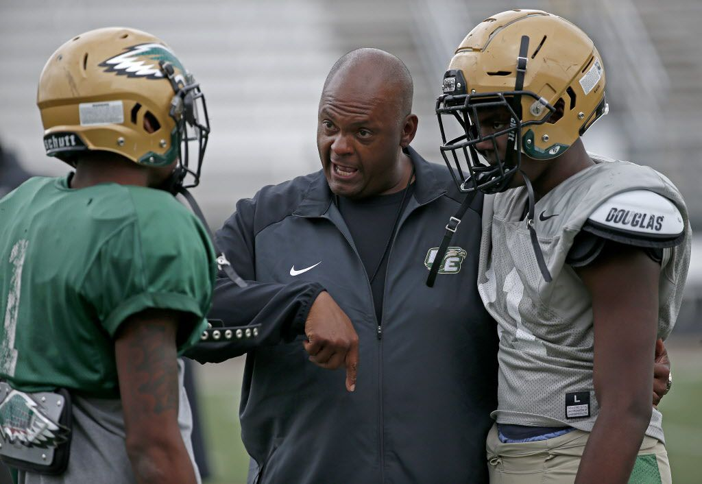 New DeSoto head coach Mike Robinson, center, talks with his players La'Vontae Shenault, left, and Jackson Bailey during practice at DeSoto High School in DeSoto, Texas, Wednesday, April 25, 2018. (Jae S. Lee/The Dallas Morning News)