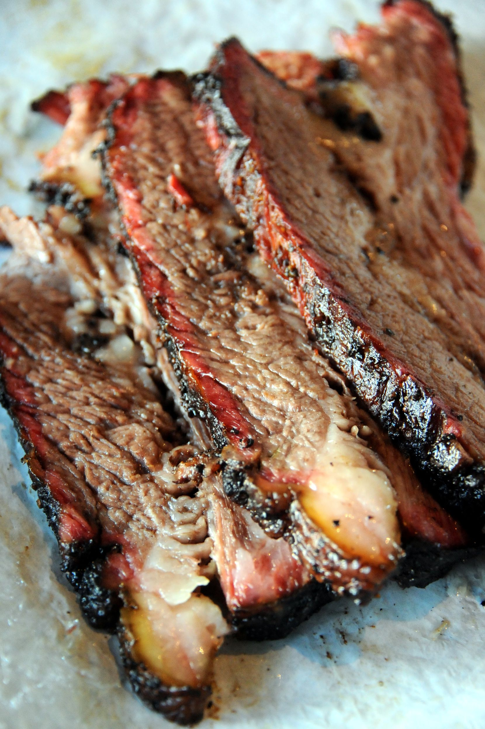 """The brisket rubbed with salt and pepper (and """"a few other seasonings,"""" says owner Larry Lavine) at the new Ten 50 BBQ in Richardson, TX on August 11, 2014."""