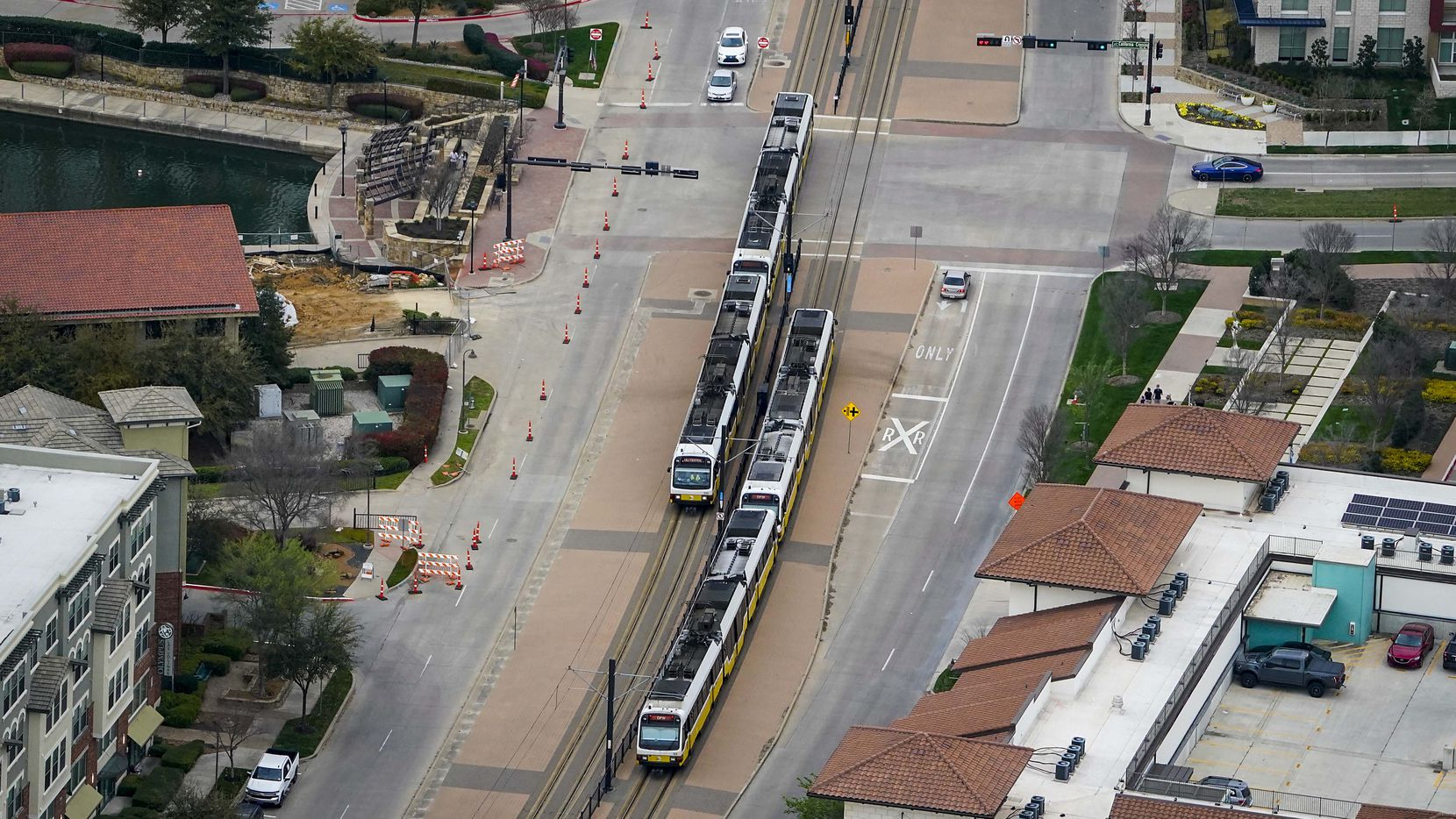 Aerial view of DART rail trains passing near Urban Center station in Las Colinas on Thursday, March 12, 2020, in Irving.