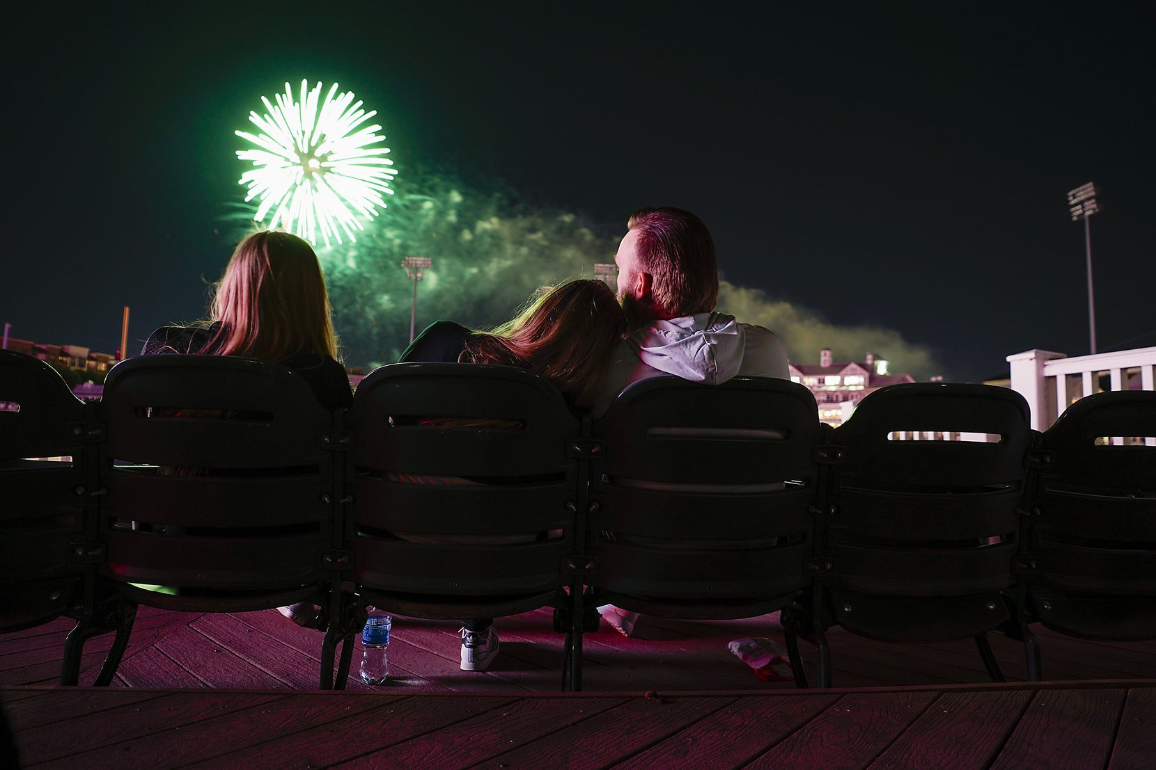 Fans watch the post game fireworks after the Frisco RoughRiders game at Riders Field. (Smiley N. Pool/The Dallas Morning News)