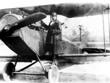 Pioneer aviator Bessie Coleman stands on the wheel of a plane in this 1920s photo. Coleman gave exhibition flights in the United States as well as Europe. She's an example of a lesser-known figure in Texas history who might be featured in a newly approved African American studies course.