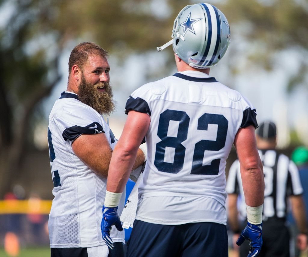 Dallas Cowboys center Travis Frederick (72) talks to tight end Jason Witten (82) during an afternoon practice at training camp in Oxnard, California on Sunday, July 28, 2019.