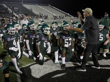 Kennedale head coach Richard Barrett speaks with his players following the Wildcats' 28-27 come-from-behind victory over Sunnyvale. The two teams played their Class 4A football game at Wildcat Stadium on the campus of Kennedale High School in Kennedale on September 11, 2020.