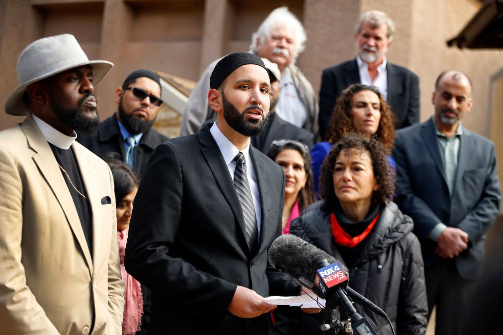 Irving Imam Omar Suleiman defends Muslims outside Irving City Hall on Wednesday. Offering support to his left are Rev. Michael Waters of the Joy Tabernacle African Methodist Episcopal Church and, on the right, the Rabbi Nancy Kasten of  Faith Forward Dallas at Thanksgiving Square. (Tom Fox/The Dallas Morning News)