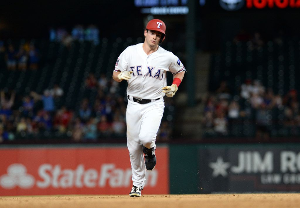 ARLINGTON, TEXAS - AUGUST 20: Nick Solak #15 of the Texas Rangers rounds the bases after a one-run home run against the Los Angeles Angels in the bottom of the fifth inning during game two of a doubleheader at Globe Life Park in Arlington on August 20, 2019 in Arlington, Texas. (Photo by C. Morgan Engel/Getty Images)