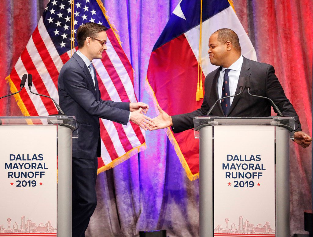 Dallas City Council member Scott Griggs (left) and State Rep. Eric Johnson, D-Dallas, shake hands following their televised one-hour debate sponsored by The Dallas Morning News, NBC5 and the Dallas Regional Chamber at El Centro College in downtown Dallas, Tuesday, May 14, 2019. The two candidates are in a runoff election to become Dallas Mayor. (Tom Fox/The Dallas Morning News)