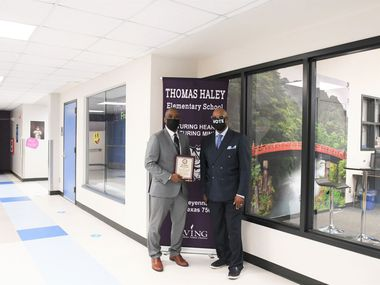 Principal Henry Taylor (left) is pictured with Tony Grimes, NAACP Irving-Carrollton chapter president and Irving ISD school board member.