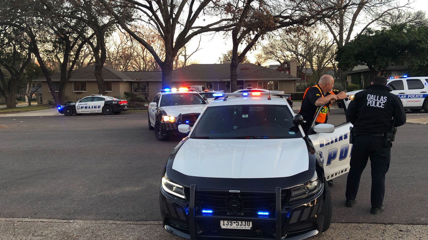 Dallas police blocked off the area where an officer crashed Sunday afternoon in the 7300 block of East Mockingbird Lane, near the northwest corner of White Rock Lake.