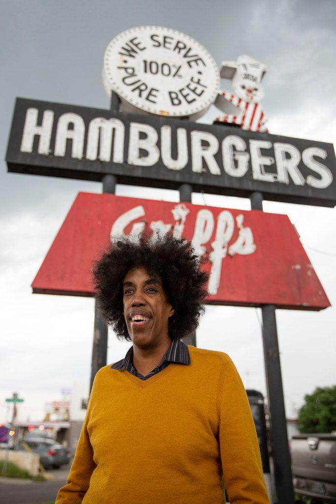 Playwright Jonathan Norton stands in front of Griff's Hamburgers in the Pleasant Grove area of Dallas on June 1.