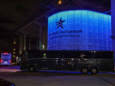 Charter buses carrying migrant teenagers arrive under Federal Protective Service escort at the Kay Bailey Hutchison Convention Center in Dallas on Wednesday, March 17, 2021.