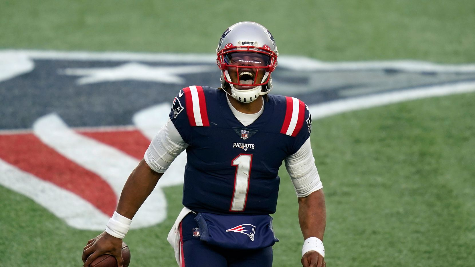 FILE — New England Patriots quarterback Cam Newton celebrates his touchdown pass to Devin Asiasi in the second half of an NFL football game against the New York Jets, in this Sunday, Jan. 3, 2021 file photo, in Foxborough, Mass.
