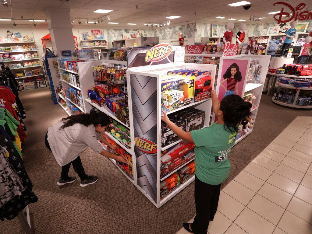 Employees straighten up the toy section at the Collin Creek Mall J.C. Penney in Plano.