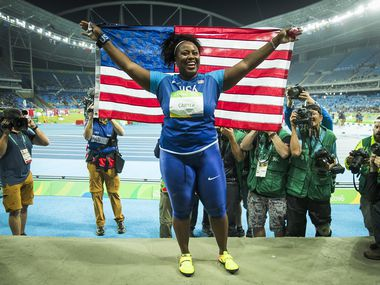 Michelle Carter celebrates after winning the women's shot put gold medal on the first day of track and field at the Rio 2016 Olympic Games on Friday, Aug. 12, 2016, in Rio de Janeiro.