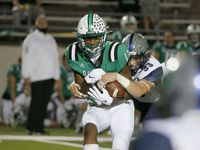 Southlake receiver R.J. Maryland (13) makes a reception and is hit by Eaton safety Ben Roberts (33) during their high school football game on Nov. 20, 2020.