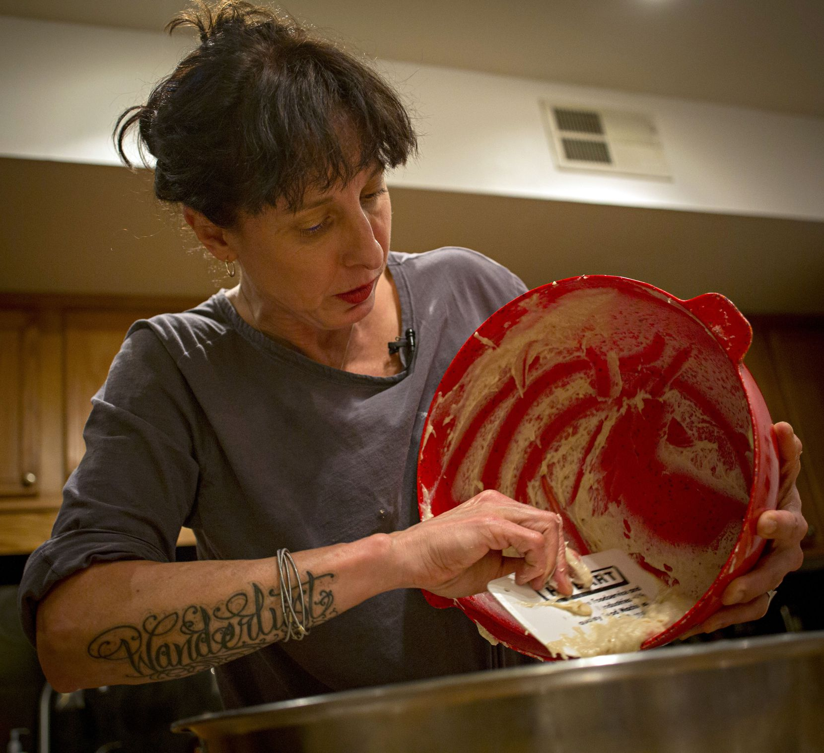 Katherine Clapner scrapes dough from a mixing bowl as she makes kolaches at her home Friday, February 5, 2016 in Dallas.
