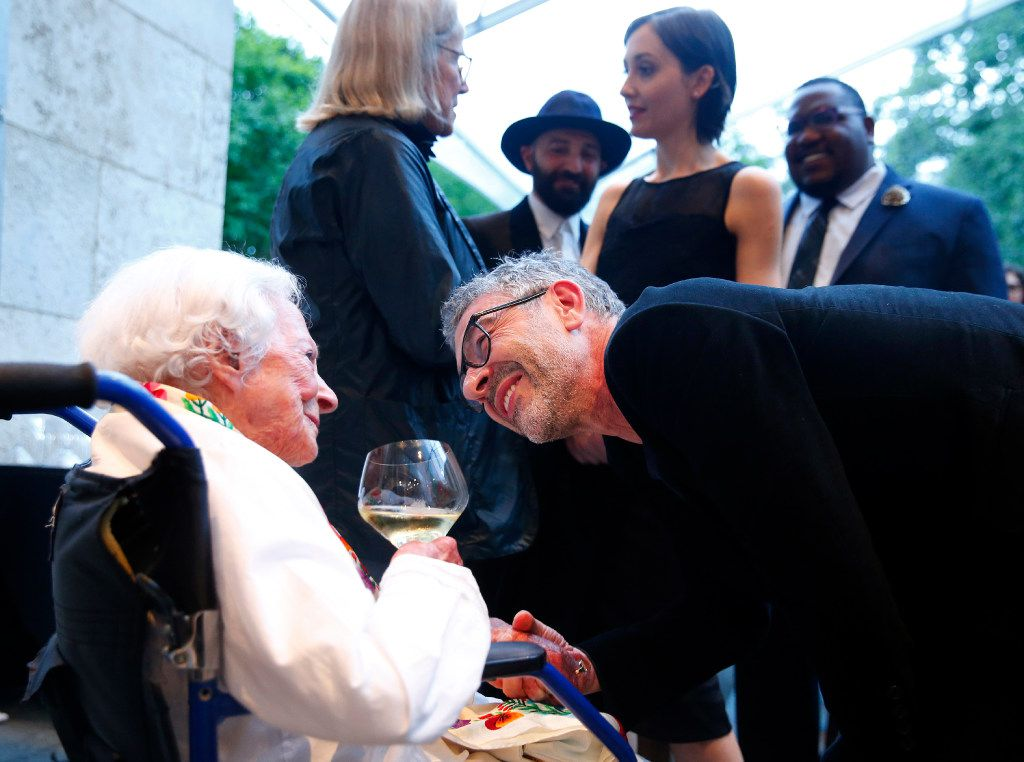 Huyghe visited with Margaret McDermott before receiving his award at the Nasher Sculpture Center in Dallas on Saturday. (Tom Fox/Staff Photographer)