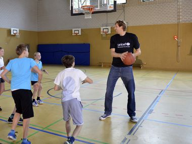 Dirk Nowitzki, playing basketball here with a group of children, will receive the Spirit of Compassion Award with his wife Jessica on Friday night at the sold-out UNICEF Gala Dallas at the Ritz-Carlton.