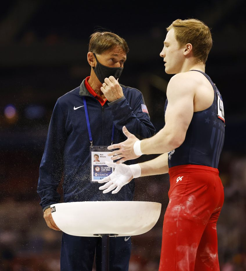 Matt Wenske talks to his coach Mark Williams at the pommel horse during day 2 of the men's 2021 U.S. Olympic Trials at America's Center on Saturday, June 26, 2021 in St Louis, Missouri.(Vernon Bryant/The Dallas Morning News)