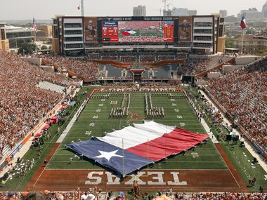 The Texas flag is spun around on the DKR-Texas Memorial Stadium before kickoff in Austin, Saturday, September 4, 2021. The Longhorns were facing the Louisiana-Lafayette Ragin Cajuns in the season opener.