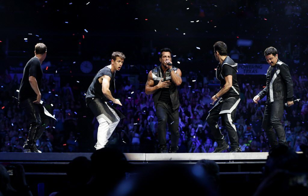New Kids on the Block member Donnie Wahlberg, Joey McIntyre, Danny Wood, Jordan Knight, and Jonathan Knight during a performance at American Airlines Center in Dallas, on Thursday, May 14, 2015.