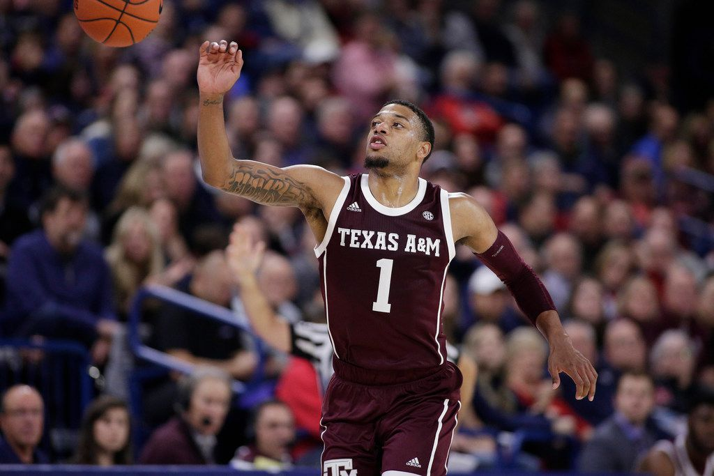 Texas A&M guard Savion Flagg (1) goes after the ball during the second half of an NCAA college basketball game against Gonzaga in Spokane, Wash., Thursday, Nov. 15, 2018.