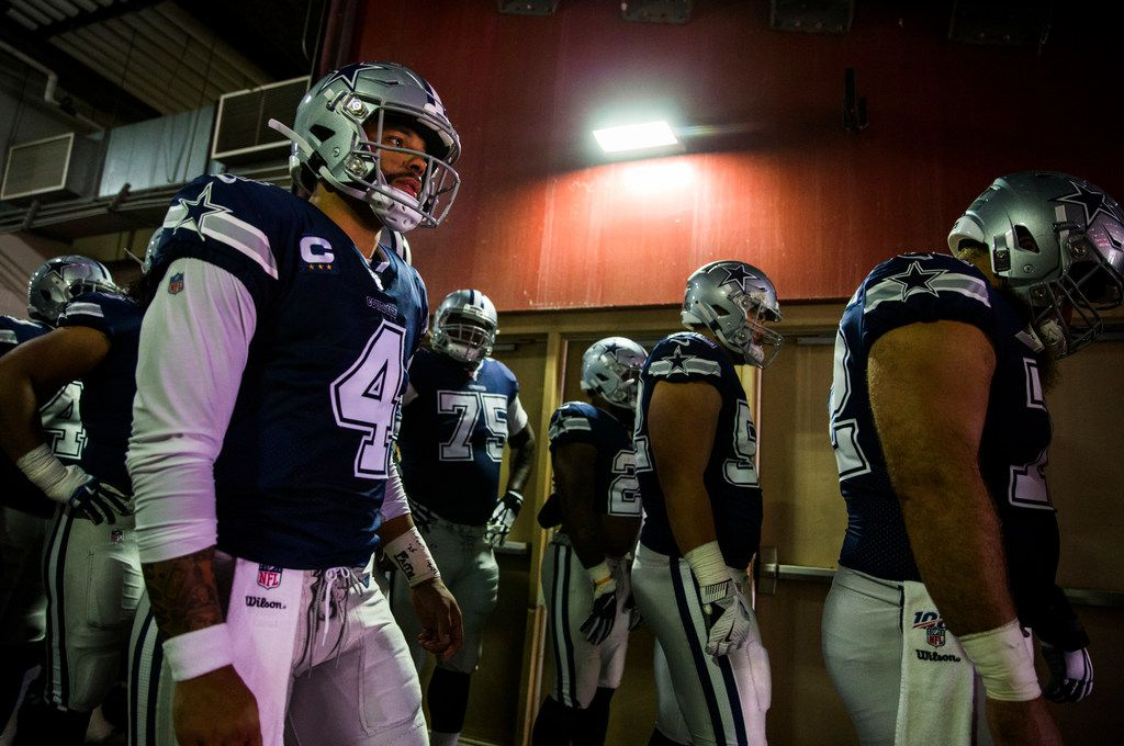 Dallas Cowboys quarterback Dak Prescott (4) and other players wait in the tunnel before an NFL game between the Dallas Cowboys and the Washington Redskins on Sunday, September 15, 2019 at FedExField in Landover, Maryland.