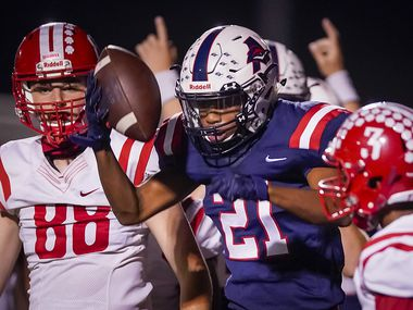 Aubrey running back  Braylon Colgrove (21) celebrates after rushing for a touchdown during the first half of a high school football game against Terrell on Friday, Sept. 18, 2020, in Aubrey, Texas. (Smiley N. Pool/The Dallas Morning News)