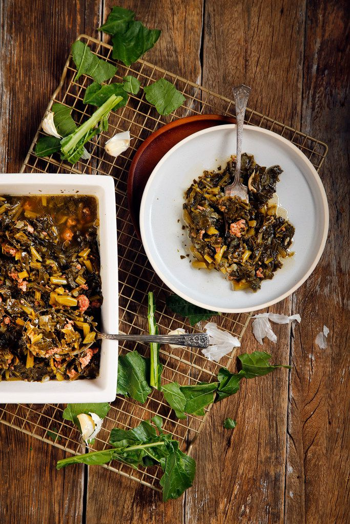 Spicy collard greens with spicy sausage and garlic.