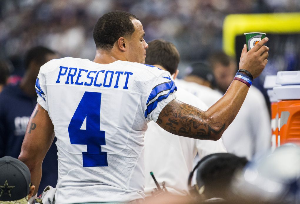 Dallas Cowboys quarterback Dak Prescott (4) throws away a Gatorade cup on the sideline during the second half of their game against the Baltimore Ravens on Sunday, November 20, 2016 at AT&T Stadium in Arlington, Texas.