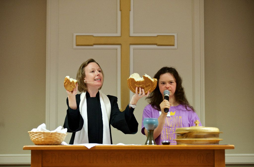 """Associate Pastor Ramsey Patton, left, breaks bread as Constance Lewis recites the communion liturgy during """"The Feast"""" church service for people with special needs at Highland Park United Methodist Church on Sunday, January 8, 2017."""