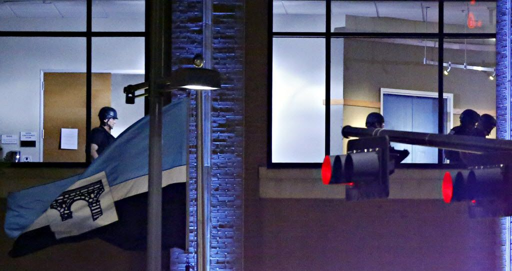 Dallas Police SWAT team members walk a second story floor at El Centro College following a deadly shooting Friday, July 7, 2016 in Dallas. As a Black Lives Matter protest wound down, a gunman opened fire, shooting 11 police officers, killing five of them. (G.J. McCarthy/The Dallas Morning News)
