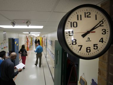 A file photo of a clock at Pleasant Run Elementary in Lancaster ISD on Monday, April 13, 2015. The district is suing a board trustee, saying she should not serve as an advocate for children with special needs.  (Tom Fox/The Dallas Morning News)