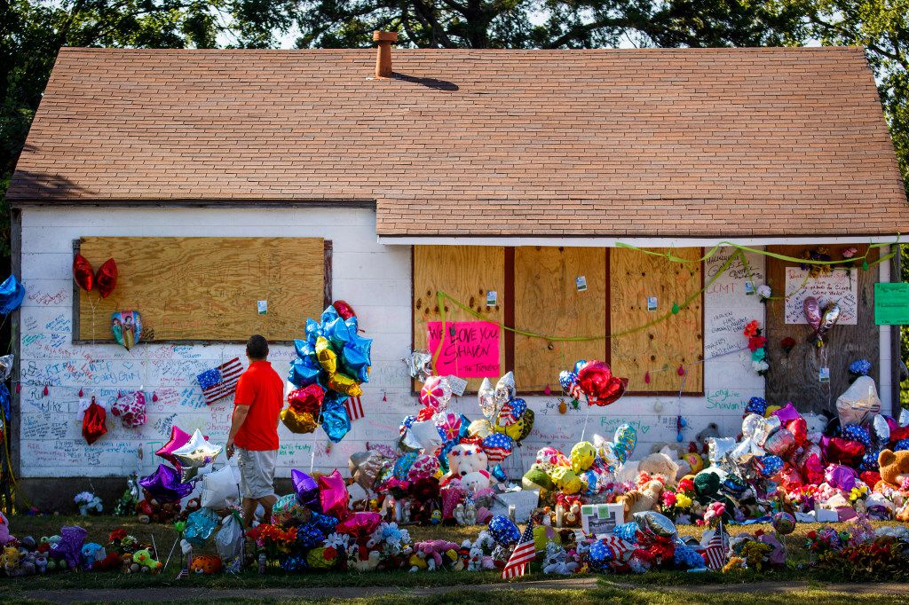 Chris Garza, who grew up in the Sunnyvale neighborhood, visited the tribute to Shavon Randle that filled the yard of the abandoned house in the 2200 block of East Kiest Boulevard where Shavon was found dead in July. (Smiley N. Pool/Staff Photographer)