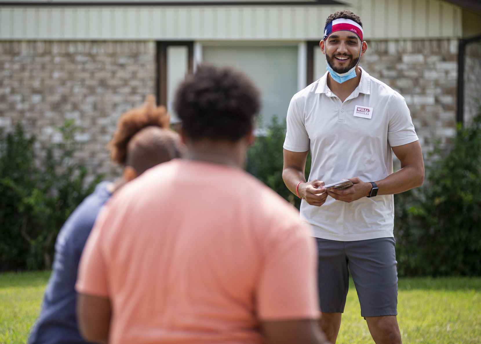 Republican candidate for Texas State House Will Douglas, stands at least six feet from potential voters Tarah Johnson and Jalen Reynolds while block walking in Garland Saturday, September 19, 2020. (Brandon Wade/Special Contributor)