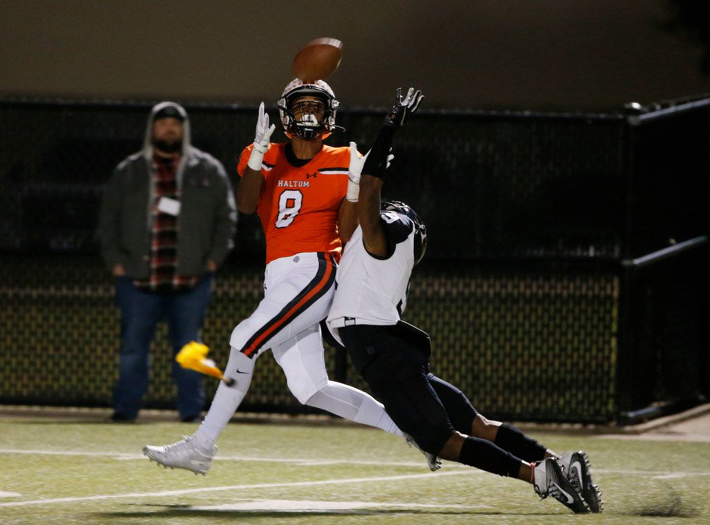 FILE - Haltom's Jace Washington (8) fails to catch a pass but is interfered with by Euless Trinity's Isaiah Smith (9) during the first half of a game on Oct. 11, 2019, in North Richland Hills.