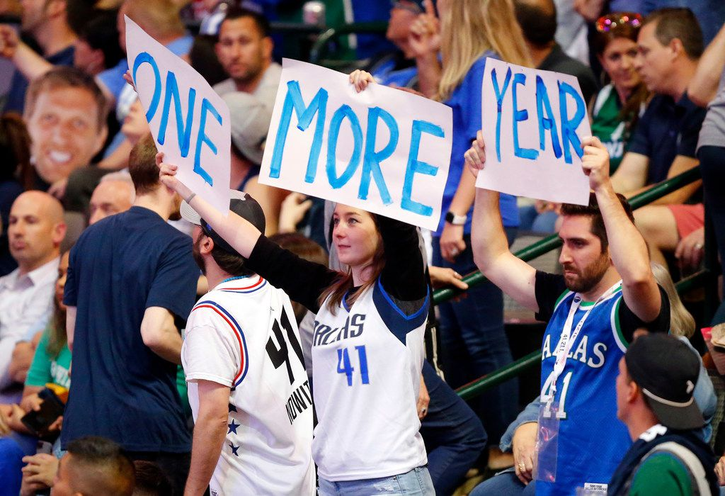 Dallas Mavericks fans encourage Dallas Mavericks forward Dirk Nowitzki to stay another year and not retire after this season during a game against the Phoenix Suns at American Airlines Center in Dallas, Tuesday, April 9, 2019. Dirk will finish out his 21st season this week.(Tom Fox/The Dallas Morning News)