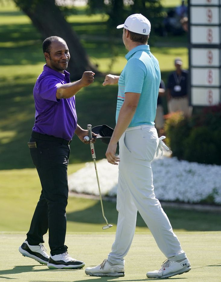 PGA Tour golfer Harold Varner III fist bumps his playing partner Jordan Spieth following their third round of the Charles Schwab Challenge at the Colonial Country Club in Fort Worth, Saturday, June 13, 2020.  Jordan is tied for second and Varner is tied for 7th. The Challenge is the first tour event since the COVID-19 pandemic began. (Tom Fox/The Dallas Morning News)